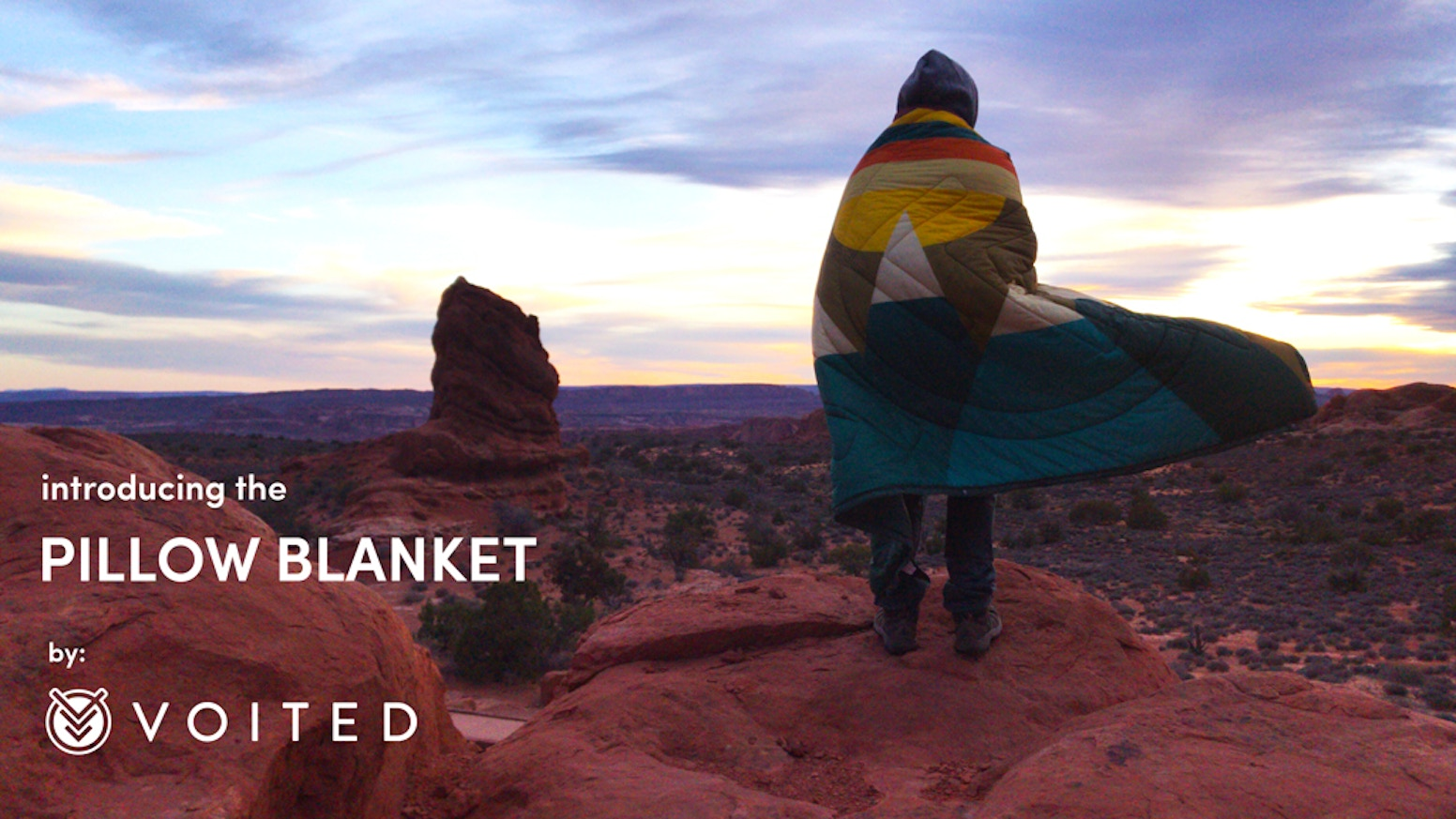 It starts as a pillow, transforms into a blanket, folds over into a sleep sack, and snaps to become a waterproof poncho.