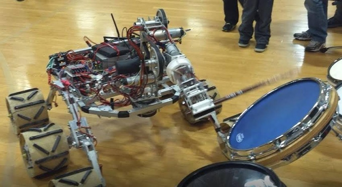 Robot giveing our drum a try