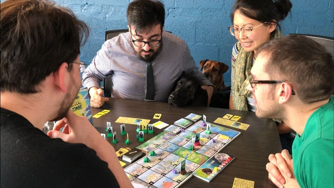 Playtesters joined by a team of good doggos, rallying to save the day!