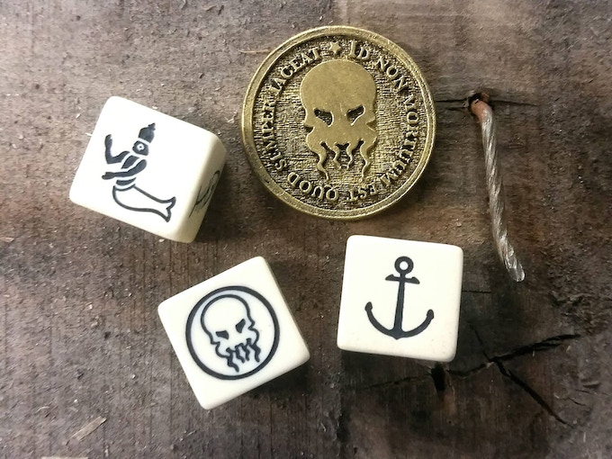 Dice and a prototype coin from Dagon's Bones.