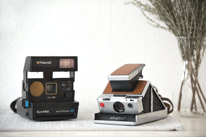Polaroid AF Sun 660 (left) and Polaroid SX-70, Alpha 1 (right)