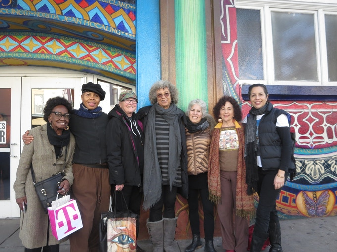 Muralists from left to right (Angela Davis in the center, of course):
