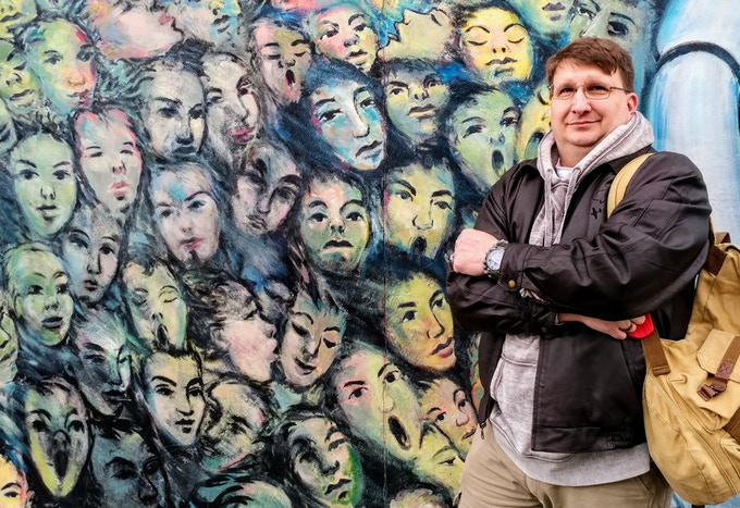 Craig Hester, Pramzius Co-Founder, at East Side Gallery March 20, 2018. Mural by East Side Gallery Executive Director Kani Alavi