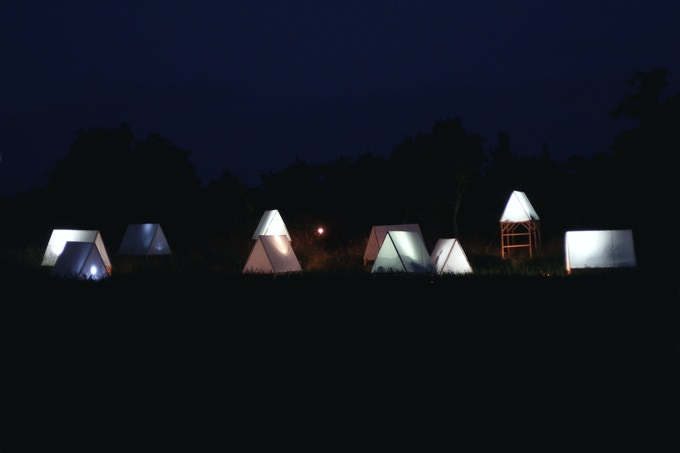 Standard issue camp tents at night