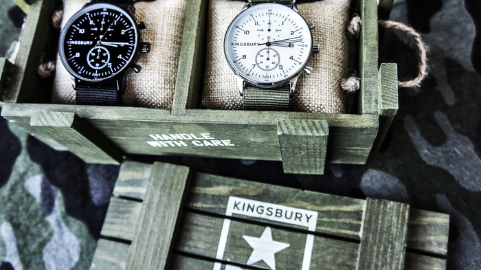 A set of two vintage looking, military inspired timepieces, complete with a mini wooden army crate and extra straps.