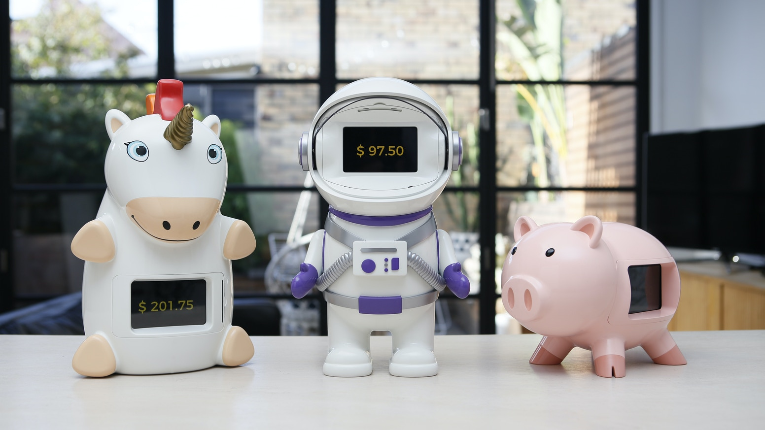 Smart piggy banks designed to help you teach your kids to save, earn and spend wisely.