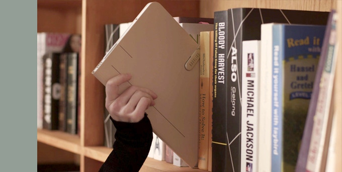 Keep your desk free of clutter by  storing your book in its Booklign on a shelf