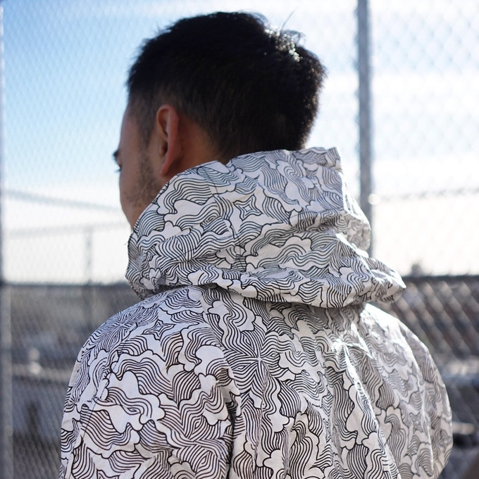 Tsunami Jacket. Black on white waveform pattern.