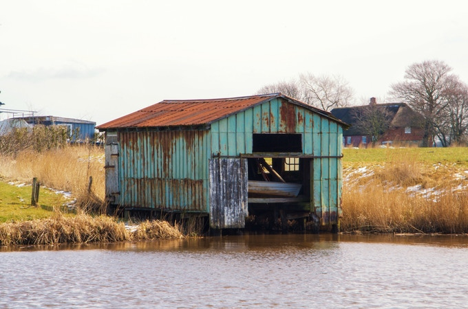 Derelict boathouse on the river Schmale in Germany