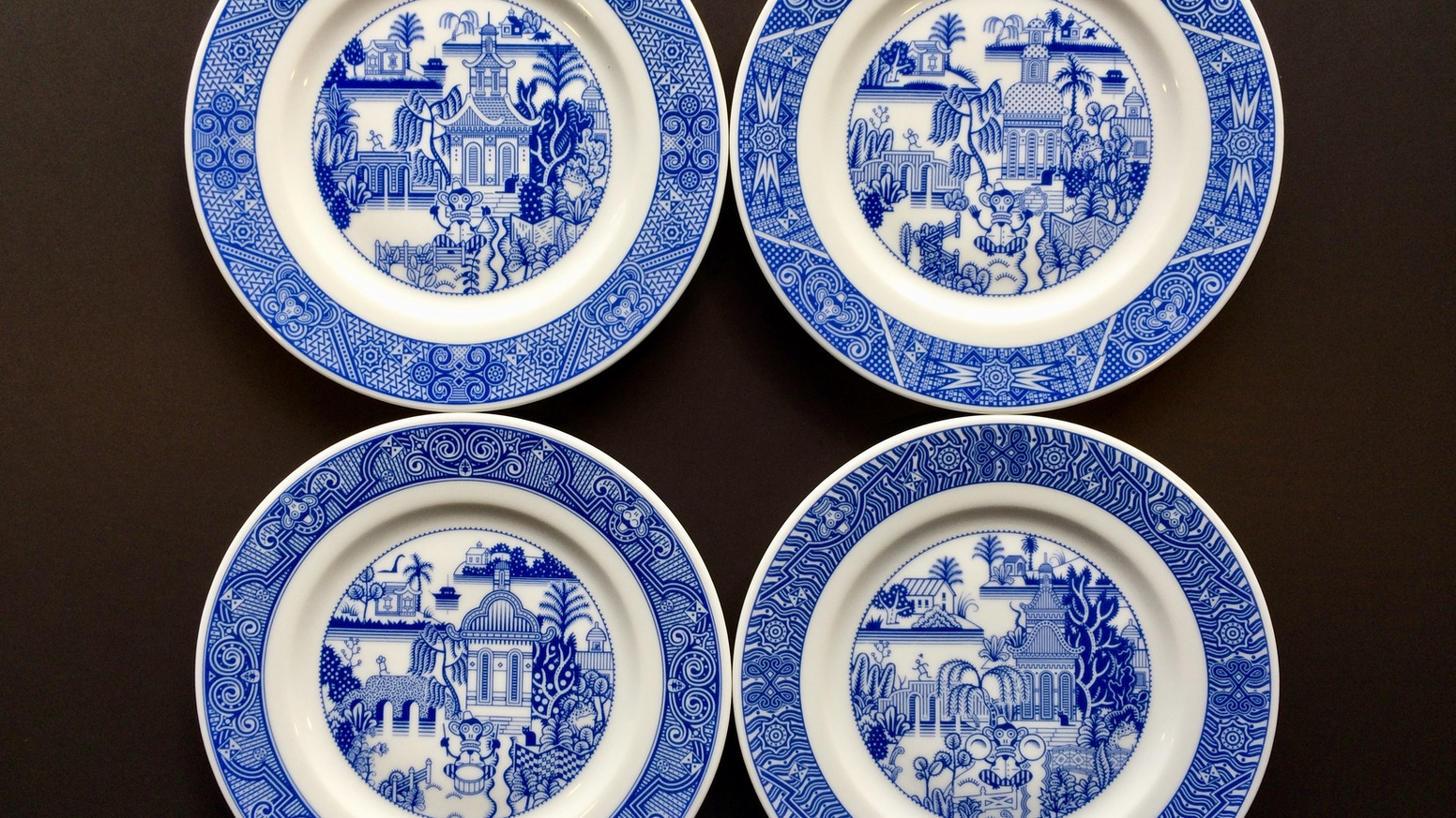 Petite porcelain plates with calamities—monkey percussionists and more.
