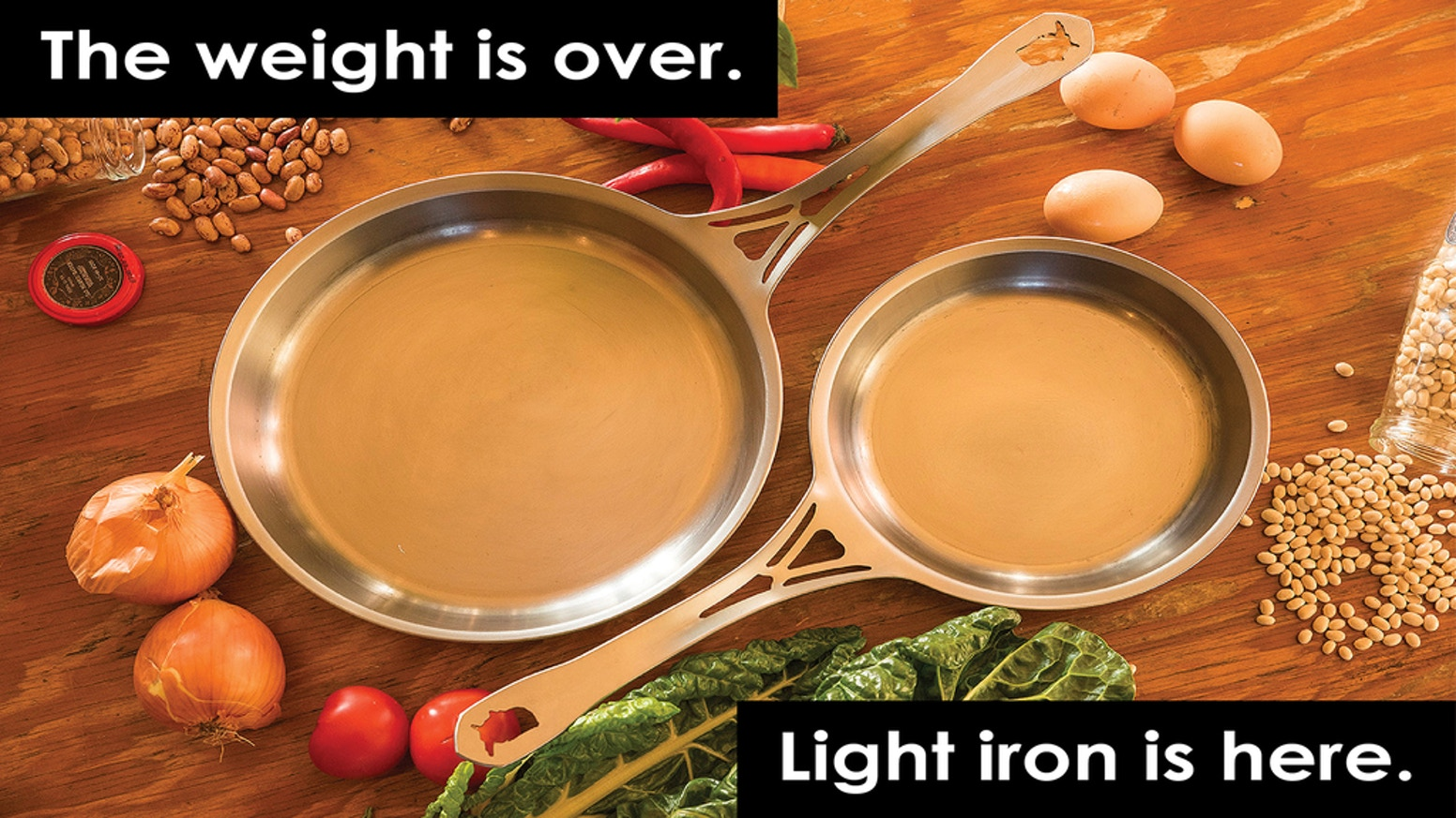"US-ION cooks/seasons like cast iron, at HALF the weight. 1/8"" thick American iron. Crafted in Chicago in 1 rivetless piece. Patented."