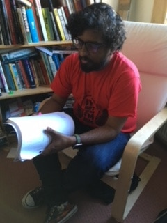 Reading an upcoming script in my home studio