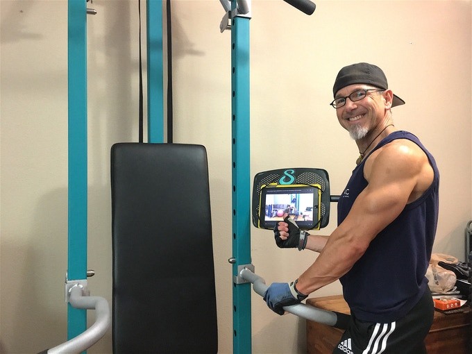 Joey Following a SCULPTAFIT 1-on-1 Personal Training Session Video On a Tablet
