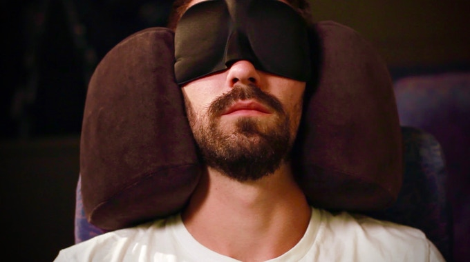 HeadHugger cradles and secures the sides of your head to help keep it from lolling around while you are sleeping.