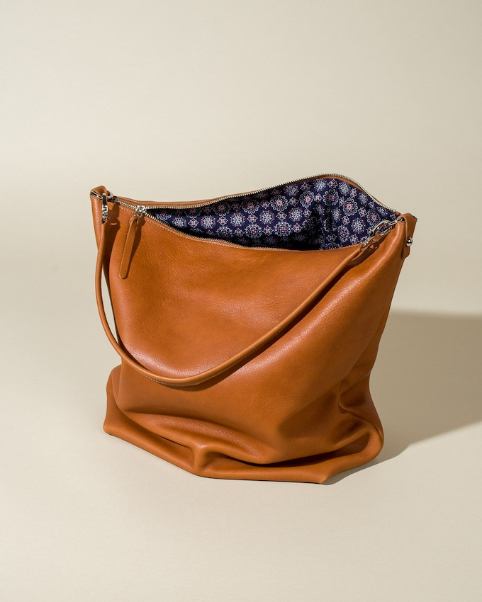 Cotton lining and a zippered interior pocket inside.
