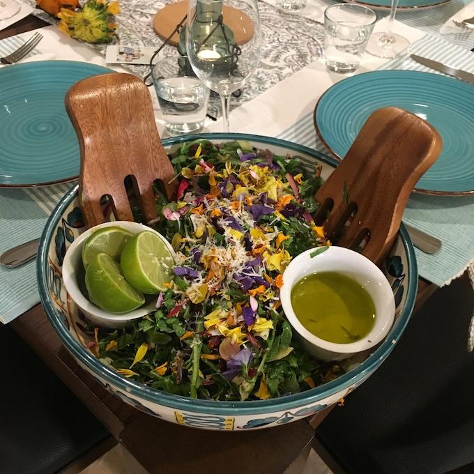 Arugula salad with edible fresh flowers.