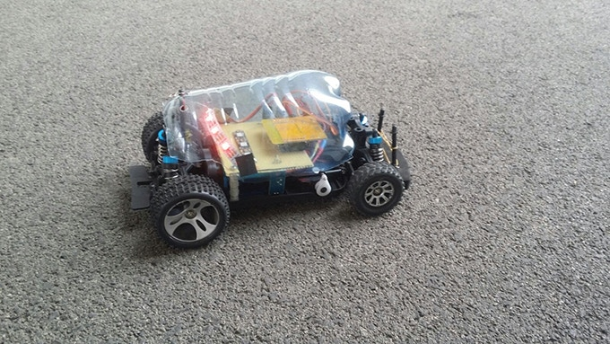 This is how xDroid started: an RC car base structure and a plastic bottle.