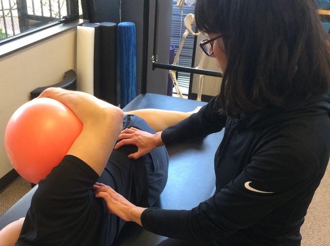 Marie instructing Pilates.