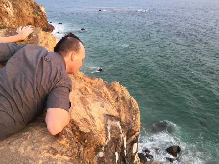 Exec. Producer Chris Vick checking out the steep cliffs - © Ginosaji Pictures