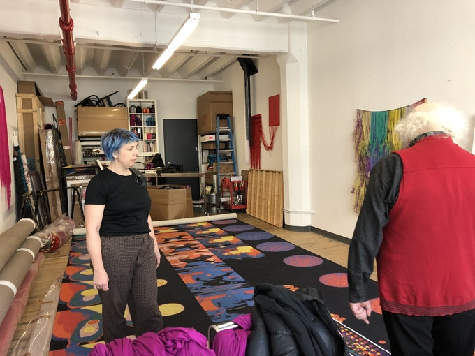 Liz Collins in her studio with Slava Tsukerman, the director of Liquid Sky, showing him the carpet she designed for the Trigger installation that was inspired by his film. Photo by Melissa Ragona
