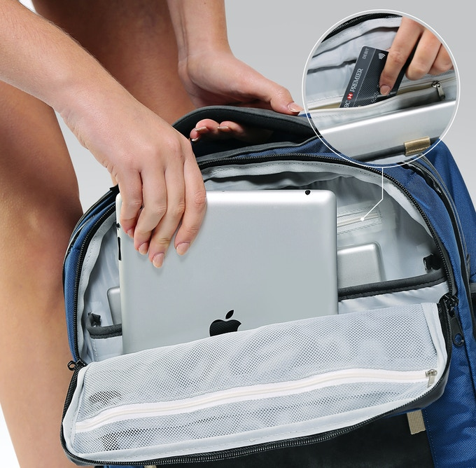 Tech compartment features iPad and Laptop compartments and an R.F.I.D. blocking pocket