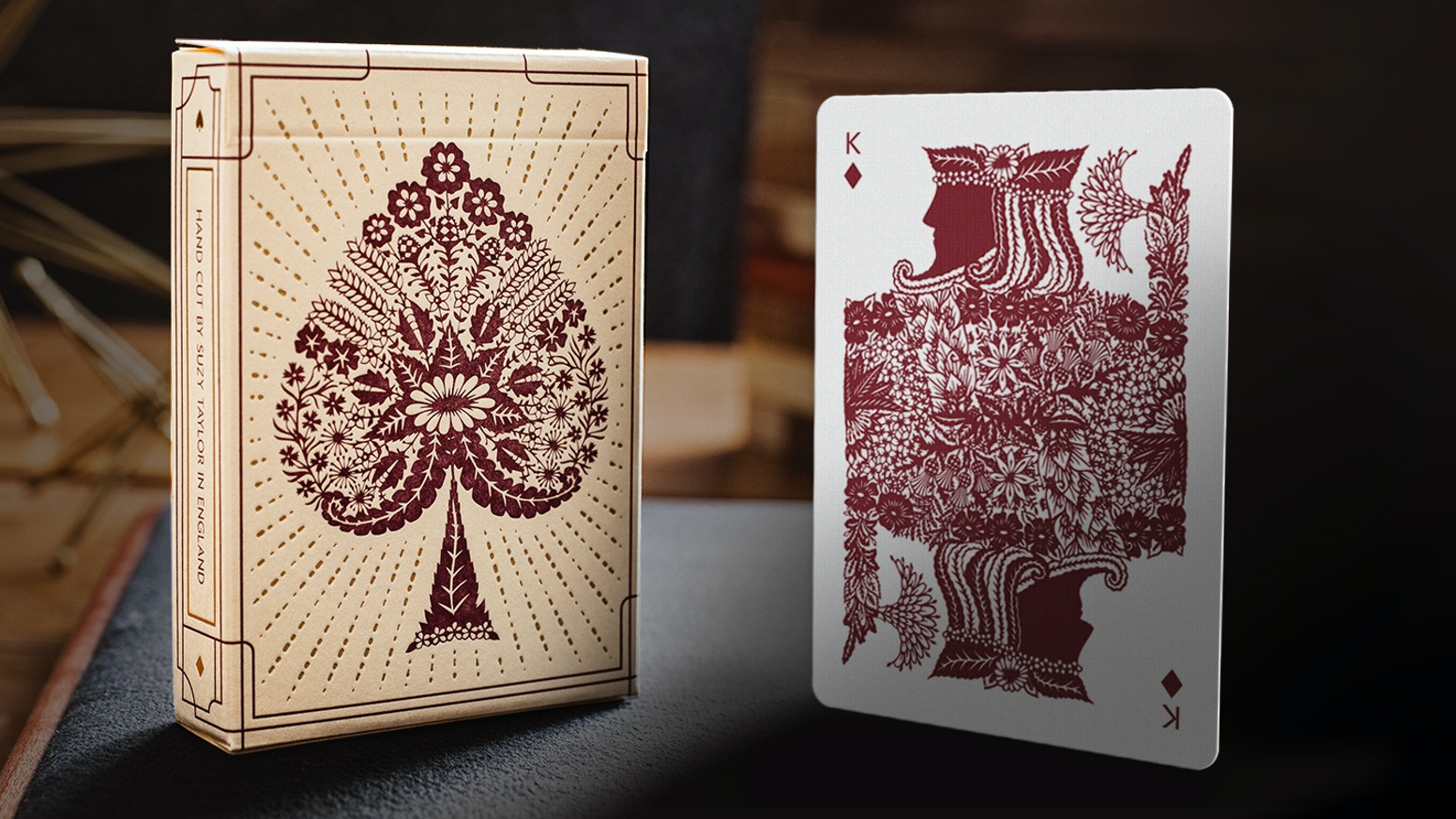 A unique set of playing cards, crafted by hand, through the delicate art of paper cutting.