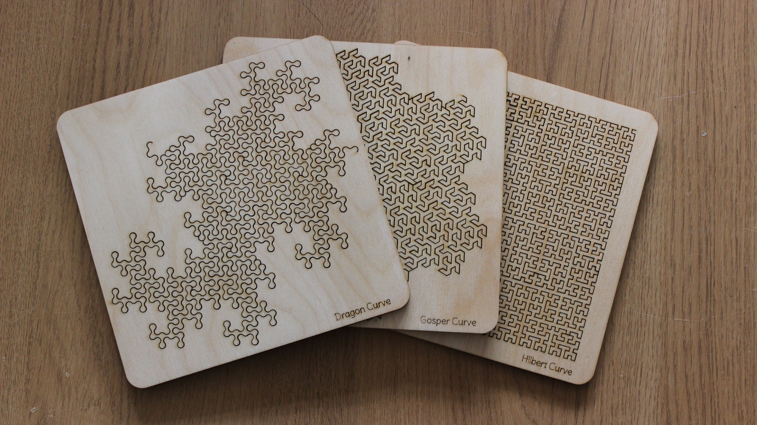 FOUR fiendishly complicated tray puzzles based upon space filling fractal curves. Often copied, but these are the original designs.