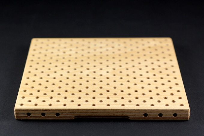 All boards have holes on the sides, too. Used for connecting to each other and for even more creative play.