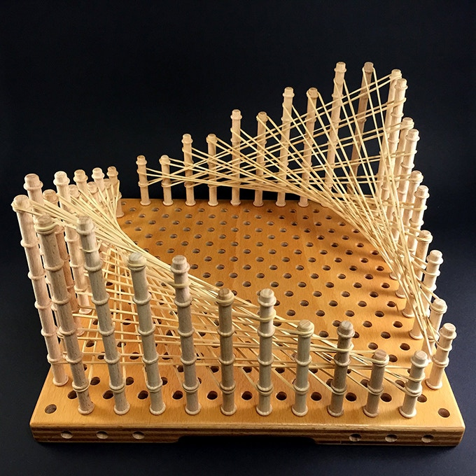 Hyperboloid. We dare you to create this with a regular geoboard :)