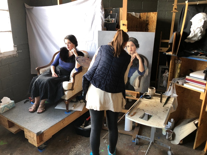 Masters Academy student Erin Morton painting a portrait