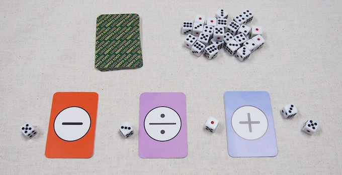 Just is played with cards and dice.