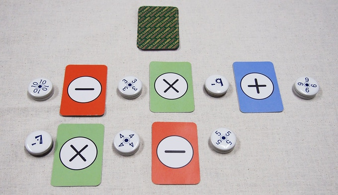 Speed is played with cards and number pieces.