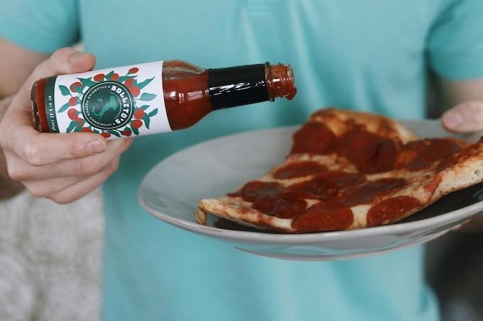 Calabrian Pepper condiment & Pizza.