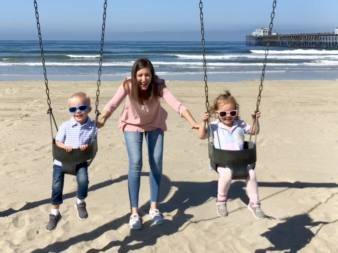 Jill on the beach in San Diego with twins Noah and Eleanor