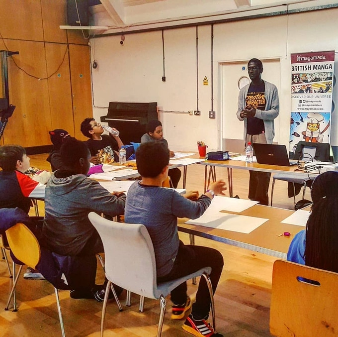 mayamada co-founder Nigel delivering a workshop with young manga fans in London