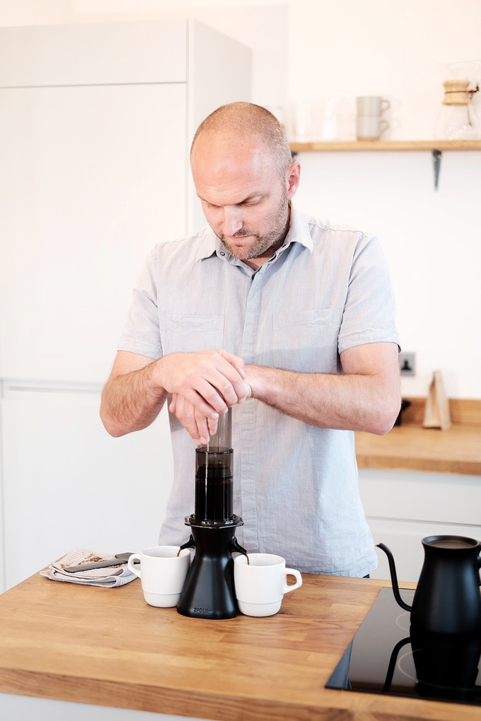 Andrew, founder of 2POUR® making a coffee with the new Aeropress® coffee maker accessory.