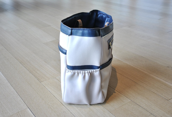 Corner: Expandable Pocket for a Water Bottle, Travel Coffee Mug, Shoes, Laptop Charger, etc.
