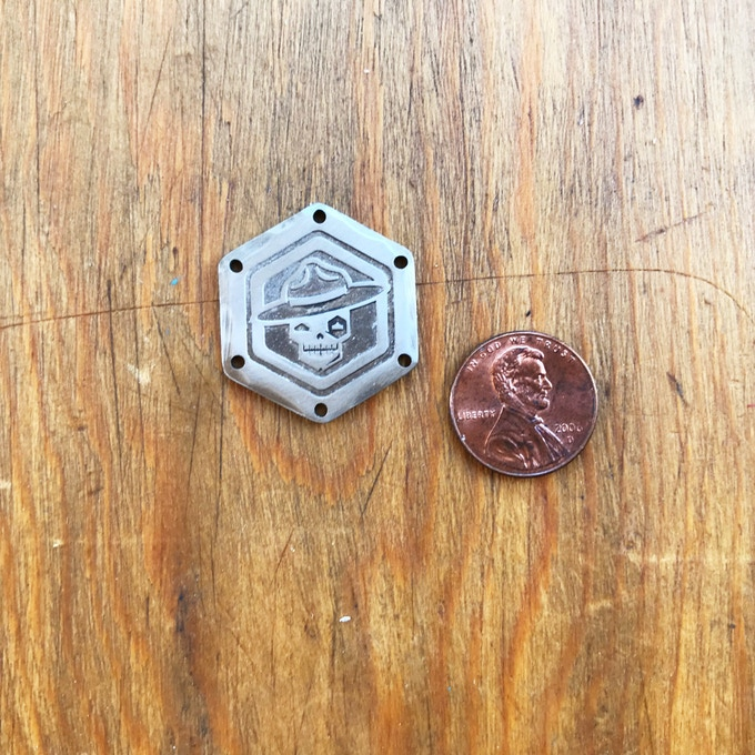 Penny included for scale only; not included.