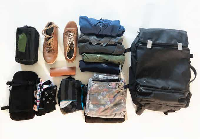 3 pairs of pants, swim trunks, 5 shirts, 3 pairs of socks, underwear, shoes, laundry bag, glasses case, and a travel toiletry bag. All of this can fit in the main compartment leaving all the other compartments open to hold even more.