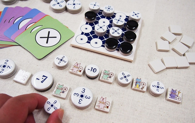 Standard and mini size pieces and arithmetic tiles.