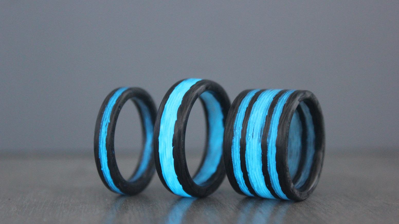 the carbon offer lume projects luminescent paul rings unique modern glow wedding forged a band and john by our fiber easley take on traditional original