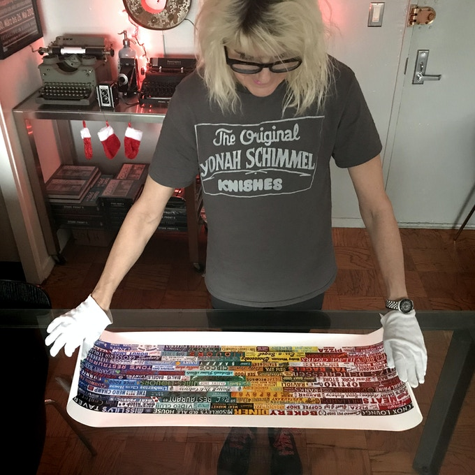 Karla showing unframed Chromatic Signage 12 x 36 inch print