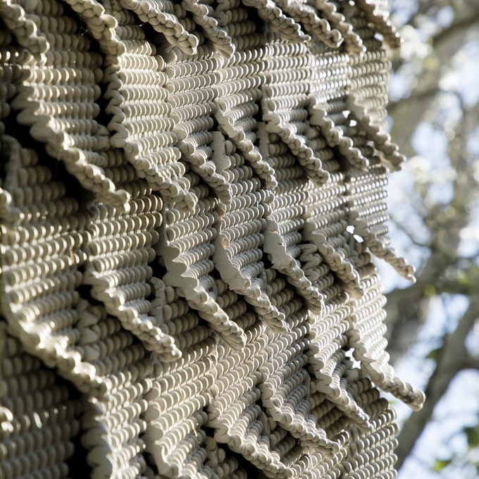 """10 Square Feet of Seed Stitch Tiles as seen on the Cabin of 3D Printed Curiosities. These tiles can be indoor or outdoor and are hung on standard 3/4"""" J moulding for drywall. You supply the J moulding and customize to your liking."""