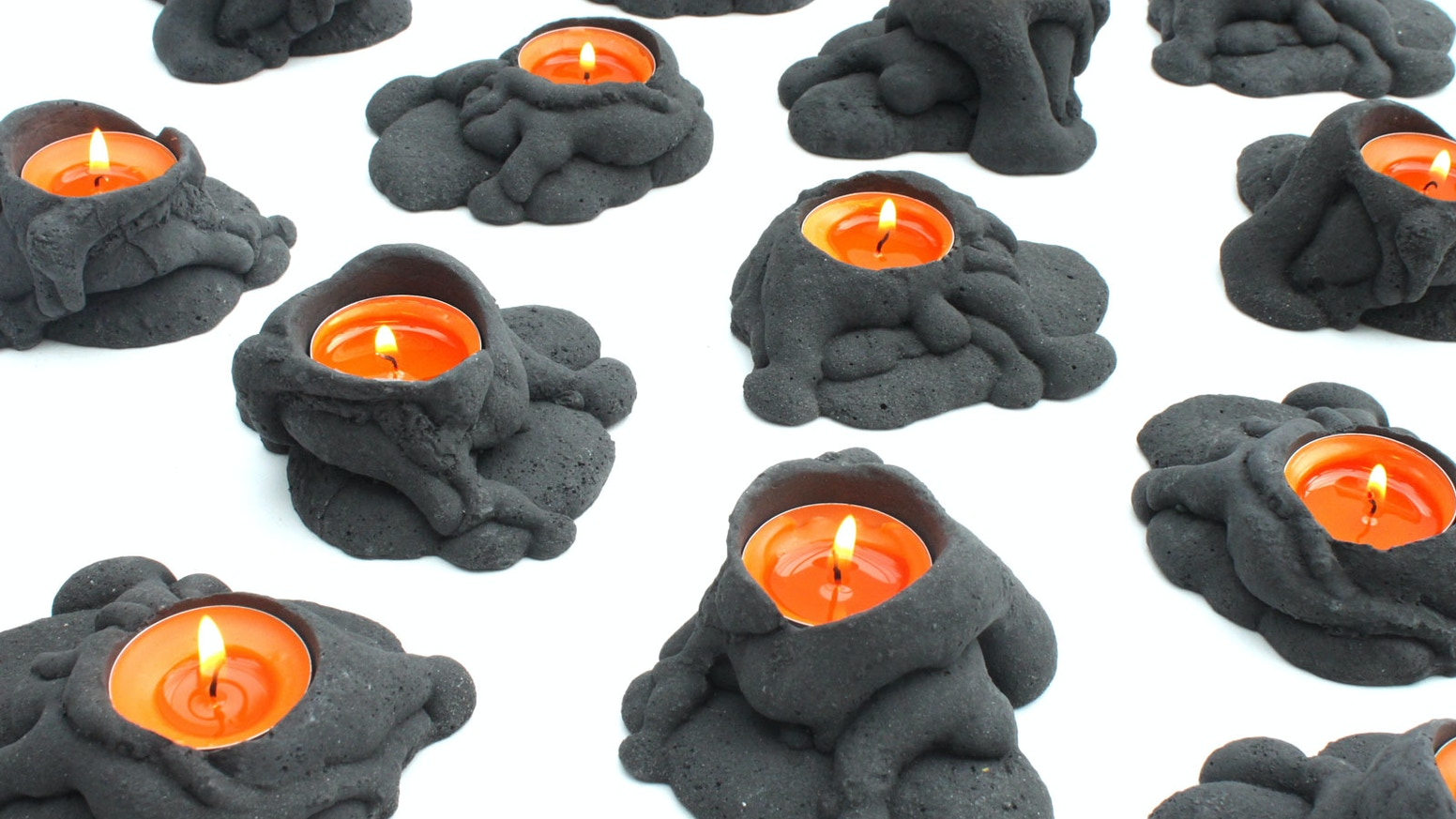 Candle holders, inspired by volcanoes. Evoking the molten glow of flowing lava.