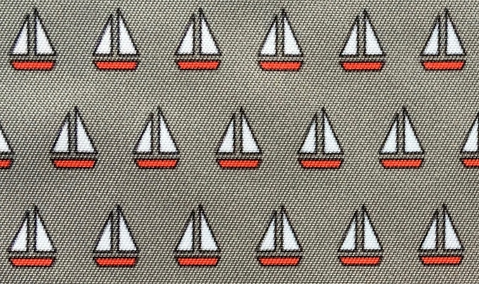 Close-up of grey lining with red boats