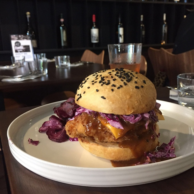 Sourdough crumbed chicken burger with Katsu curry sauce and wasabi slaw