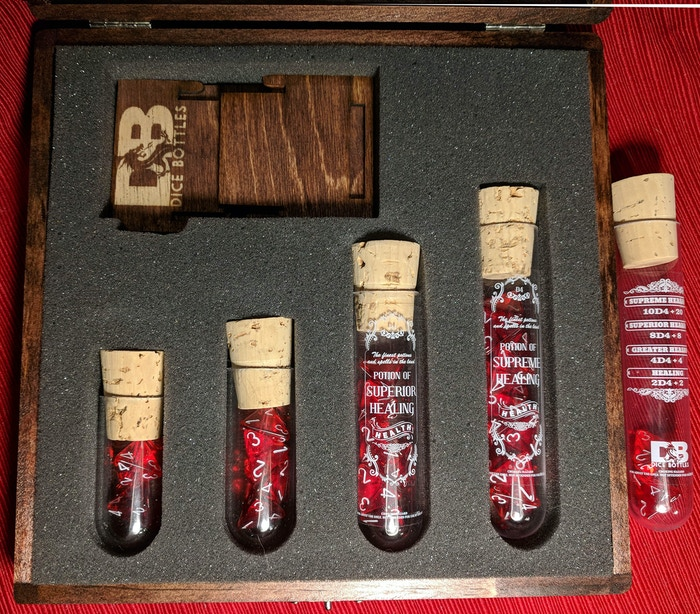 Old School option - Labels on the two vials that can fit it. Shows Kickstarter backer exclusive extra vial with two dice