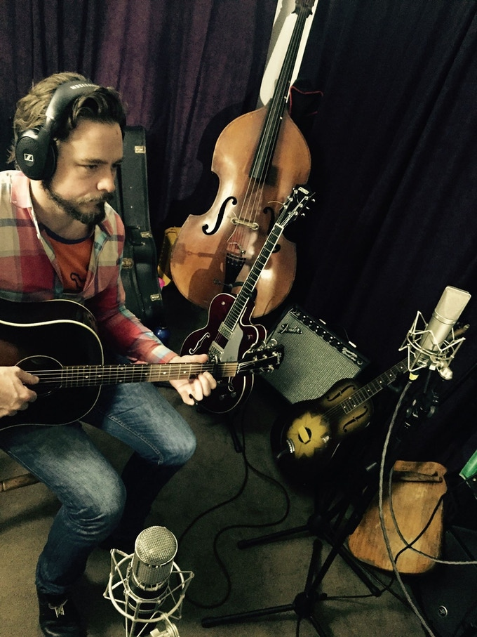 Our recording engineer, Indie Singer/Songwriter, Chris Gillespie set the tone on the Bass and added a bit of sunshine on the Dobro