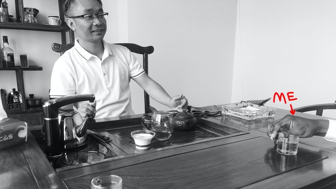 Drinking very expensive tea with the boss man.