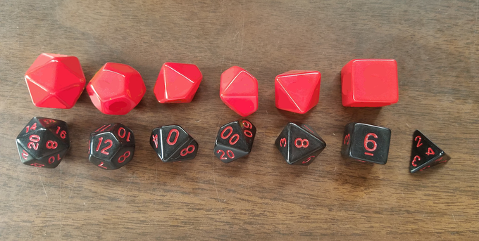 The dice on top will be the size of the Large Print Dice, the ones below are standard size.